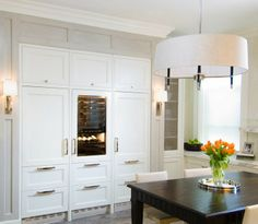 There are tons of companies out there that can make custom panels to match your cabinetry! Read on HGTV that Frigo Designs is a good choice.