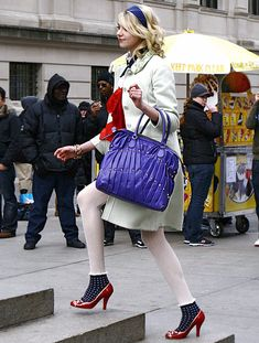 """Season 1, Episode 14: """"The Blair Bitch Project""""  Jenny Humphrey (Taylor Momsen) looked preppy wearing a Valentino coat and bag, Ellen Tracy tights, Juicy Couture socks and Moschino shoes."""