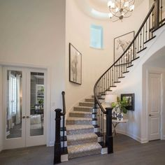 Highland Homes plan 297 in Prosper, Texas at Parkside Prosper community. House Staircase, Entry Stairs, Curved Staircase, Staircases, Bloomfield Homes, Interior Exterior, Interior Ideas, Highland Homes, New Home Builders