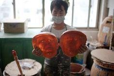 A worker checks the Trump masks
