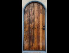 This roundtop entry door is made from a skip sanded mix of old wood from Idaho barns.