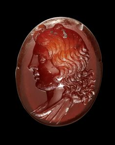 Gemstone made of red cornelian showing a bust of Apoll. Hellenistic, 2nd century B.C.