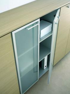 Detail of the low cupboard with open glazed door. This is the solutions with shelves  //  ---  //  Dettaglio del mobile contenitore con l'antina in vetro aperta. Questa è la soluzione con le mensole