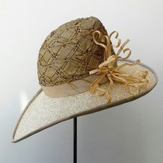 Textured woven straw and sisal hat with curled braided straw trim.