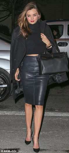 February 2014 Leggy lady: Miranda strutted around freezing New York in just a leather skirt and midriff top