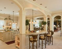 Love the pillars to keep everything open and flowing from kitchen to dinning to living room