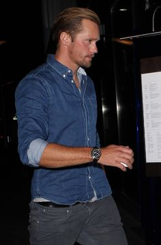 Alexander Skarsgard looks cool in his double denim outfit as he arrives at Hakkasan Restaurant in Beverly Hills, Calif. Interesting, this style: he coordinated a pair of dark grey, almost black straight-cut jeans with a medium blue denim shirt....