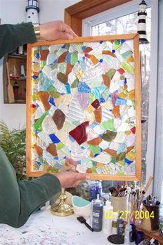 Mosaic made of sea glass - light shines through like a stained glass window