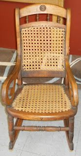 antique rocker, cane & wood - in the 1800's my family made Taylor chairs and rockers - caned or painted.  Much like this one