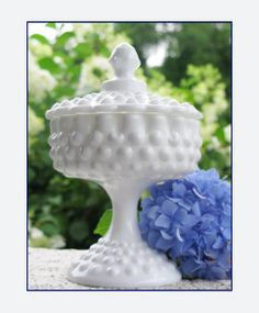 Fenton Hobnail Milk Glass Covered Pedestal Candy Dish. $28.00, via Etsy.