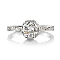 1.13ct I/SI1 EGL certified vintage Cushion cut diamond set in a handcrafted platinum mounting. A solitaire design featuring a bezel set diamond, detailed gallery and delicate engraving.