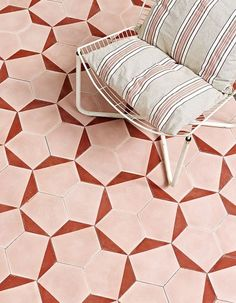 We're in love with this floor tile pattern. The perfect way to add color to an outside space.