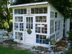 Kathryn Buckley Here is this Kathy's version of a greenhouse made from old windows shed design shed diy shed ideas shed organization shed plans Old Window Greenhouse, Lean To Greenhouse, Backyard Greenhouse, Greenhouse Plans, Backyard Sheds, Greenhouse Wedding, Underground Greenhouse, Cheap Greenhouse, Portable Greenhouse