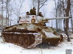 """A T-34,1943 Model,of the 30th Guards Tank Brigade enters Krasnoye Selo on the Leningrad Front,January 1944.On the turret side is marked with the Order of the Red Banner,followed by the vehicle tactical number and is named """"Leningradets""""."""
