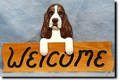 English Springer Spaniel Welcome Sign. The English Springer Spaniel - Welcome Sign is a reproduction of an original woodcarving by Michael Park, a Master woodcarver, recognized worldwide for his detailed carvings and reproductions. Each welcome sign is hand routed and hand painted by master artists capturing a style of charm and warmth.