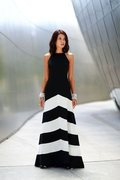 Shop this look on Lookastic:  http://lookastic.com/women/looks/black-and-white-chevron-evening-dress-silver-bracelet/10481  — Black and White Chevron Evening Dress  — Silver Bracelet
