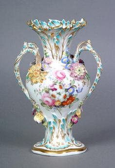 This floral-encrusted Coalbrookdale vase dates from 1825-1830. The flowers were all made by hand and the flower-maker was expected to make one china rose every 30 seconds. This was a very skilled task.