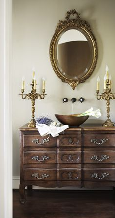 French commode repurposed as vanity with vessel sink