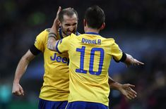 Giorgio Chiellini of Juventus celebrates with Paulo Dybala of Juventus during the UEFA Champions League Round of 16 Second Leg match between Tottenham Hotspur and Juventus at Wembley Stadium on March 7, 2018 in London, United Kingdom. - 179 of 209