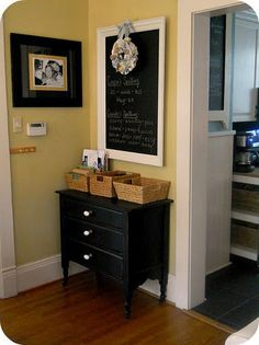 I love the chalk board and baskets for staying organized, such a fun way to use a random corner