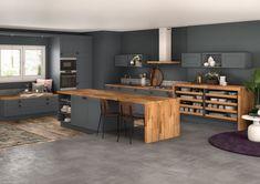 Une cuisine qui oscille entre un bois doux et du gris contemporain