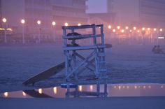 Virginia Beach, VA... I remember hanging out on the lifeguard tower at night, watching families trying to find hermit crabs in the sand :)