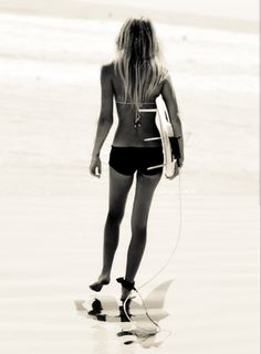 Surfing...if I don't succeed, at least I will try my damnedest to look like a surfer chick!