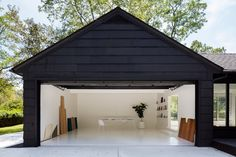 The artist converted a house on Long Island into a clean space to quiet her mind — and get to work. The artist converted a house on Long Island into a clean space to quiet her mind — and get to work. Garage Renovation, Garage Remodel, Attic Remodel, Garage House, Garage Office, Garage Halloween, Garage Door Opener, Garage Doors, Carport Garage