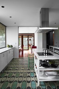 Small kitchen with a simple décor and bold patterned flooring