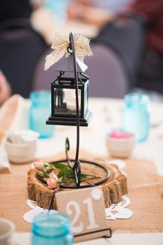 Just a touch of burlap bow on this country style centerpiece.