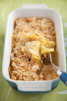Paula Deen's Cheesy Squash Casserole  1 tablespoon vegetable oil   6 medium yellow summer squash, thinly sliced   1 large Vidalia onion, thinly sliced   1 tablespoon butter   1/2 cup grated Parmesan   1 cup shredded sharp Cheddar   1/2 cup sour cream   Salt and freshly ground black pepper   1 sleeve crackers, crushed medium to fine (recommended: Ritz)