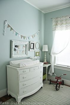 This is the exact same dresser I just bought for thirty dollars on Craigslist for my son's nursery/changing table! I just need to decide how I want to paint the hardware...
