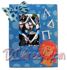 Frame from project pack 1. Remove glass and paint. Stenciled dots using stencil from project 3. Paint wood letters from supply sack white and glue on frame. Glue on lion from supply sack. Make bow with wide ribbon in sack and glue on as well.  DIYGreek.com   #alpha #delta #pi #lion #sorority #craft #sister #greek