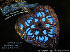 'Blue Frost Silver Dahlia Heart Glow Locket™' is going up for auction at 10am Tue, Dec 4 with a starting bid of $5.