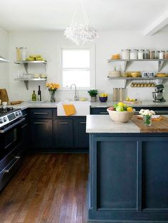 Inky Blue. Combine with white? Might just work Denim blues aren't just for your wardrobe -- they're also perfect for a feel-good, classic interior. Deep, inky blue adds a note of drama to this 1950s farmhouse-style kitchen, and it stands in contrast to the white walls and countertops. A funky chandelier and open metal shelving infuse this composed space with contemporary flair..
