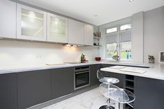 Small kitchen design in two tone finish: Handleless Anthracite grey laminate base units and light grey laminate wall units. #smallkitchen #kitchen