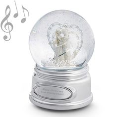"♫ Plays ""Mendelssohn's ""Wedding             March""                                                     This beautiful wedding snow globe is a great way to say ""forever"" on their      wedding day. The bride and groom in the globe stand under a beautiful           silver-scrolled arch, which shows great attention to detail in this piece. Add  your own details with an engraving that makes this gift a one of a              kind.- Engrave your congratulations to the happy..."