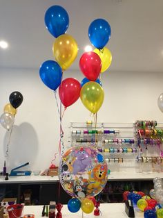 "Cute ""Party Animals"" bubble with primary coloured latex set into floor arrangements for this circus themed birthday party"