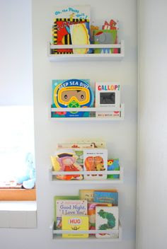 How to use IKEA spice racks for books. These are the easiest DIY wall mounted bookshelves - perfect for nursery or kids room decor! Spice Rack Bookshelves, Wall Mounted Bookshelves, Wooden Shelves, Wall Shelves, Ikea Spice Racks As Book Shelves, Ikea Spice Rack Hack, Organizing Bookshelves, Bookshelves Ikea, Spice Shelf