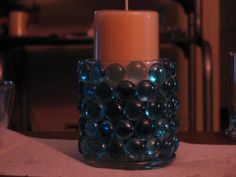 Gem Candle Votive: I used a small round votive and used E-6000 glue to glue blue gems around the votive.