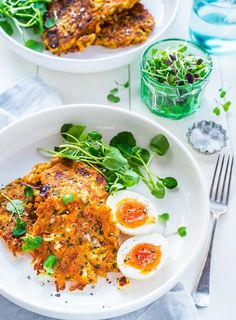 Sweet and spicy carrot and chickpea fritters with chunks of salty feta. Serve with runny soft boiled eggs and peppery watercress.