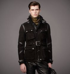 The Norfolk's classic riding jacket shape finds definition in contrast leather caging details. Natural shearling lining provides warmth from the inside out. Roller bar buckle cuff and belt define a structured fit. Double leather tabs secure the collar.