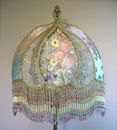 Pretty antique floor lamp holds a custom Teardrop Shadowbox shade filled with exceptional Victorian embroidered flowers in delectable pastel colors. Other panels are covered in vintage silk cut velvet Victorian Lampshades, Lamp Shade Crafts, Beaded Lamps, Metal Lace, Lamp, Beaded Lampshade, Beautiful Lamp, Victorian Lamps, Victorian