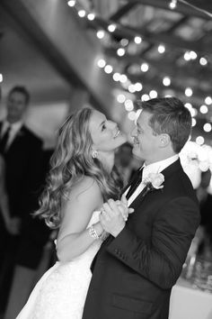 Great black and white photograph/wedding dance. I love how candid it looks. Photography: Julie Roberts.