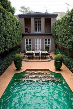 Good idea for a narrow lot...just need a guest house...on this end of pool...