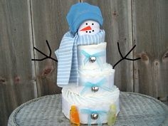 ***HOLIDAY SPECIAL*** FREE GIFT WITH PURCHASE OVER $50***excluding shipping chages!! This Snowman Diaper Cake for Boys is the perfect centerpiece