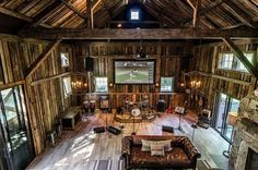 Rarely have I driven by a farm with an old barn without thinking how cool it would be to convert it into a gym, home office or other cool space. The owner of this barn has done just that. This converted barn conversion is the coolest man cave I have ever seen. It was designed and engineered by