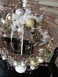 Christmas wreath made with dollar store ornaments and baby's breath