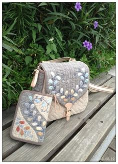 Matching feather variation bag and wallet