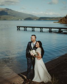 Lizz and Jade just married and on the shores of Lake Tarawera New Zealand . . . #hawkesbayphotographer #napierphotographer #hawkesbayphotographers #napierphotographers #rotoruawedding #laketarawera #weddingphotographer #nzwedding #nzweddingphotographer #tribearchipelago #loaf #loafman #loaf03 #lookslikefilm #nikon #d750 #hellomay #junebugwedding #instawedding #instabride #reallove #realwedding #realcouple #lakeside #lake #sunset